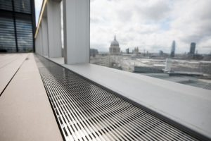 Metal drainage grille at One Bartholomew Close overlooking St Pauls, London